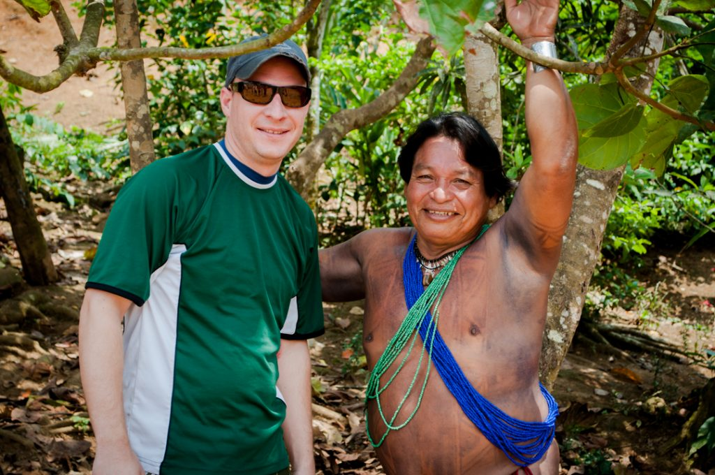 Me standing in the Panamanian jungle with a native Indian tribe leader.