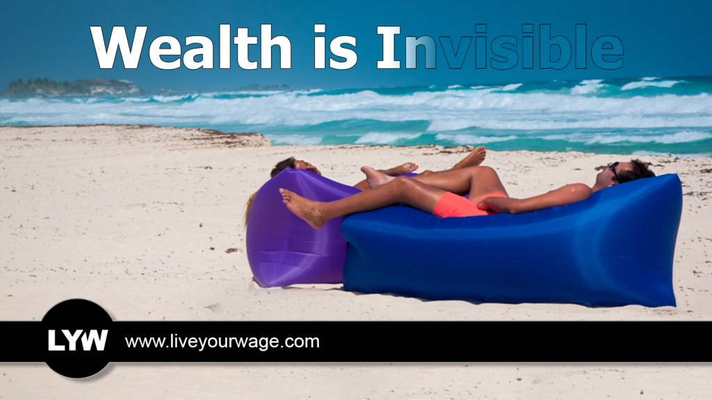 Couple lying on the beach on a hammock.