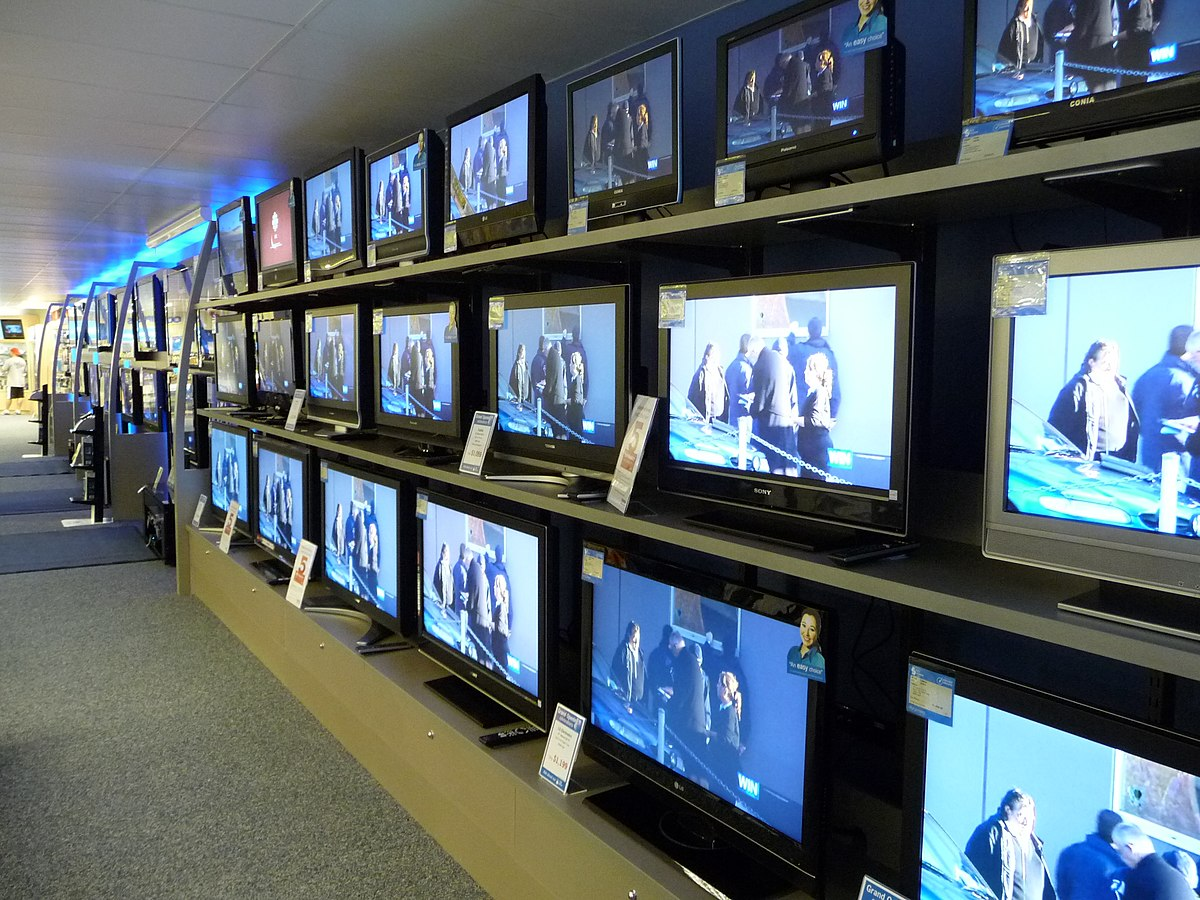 A line of TV's in a store.