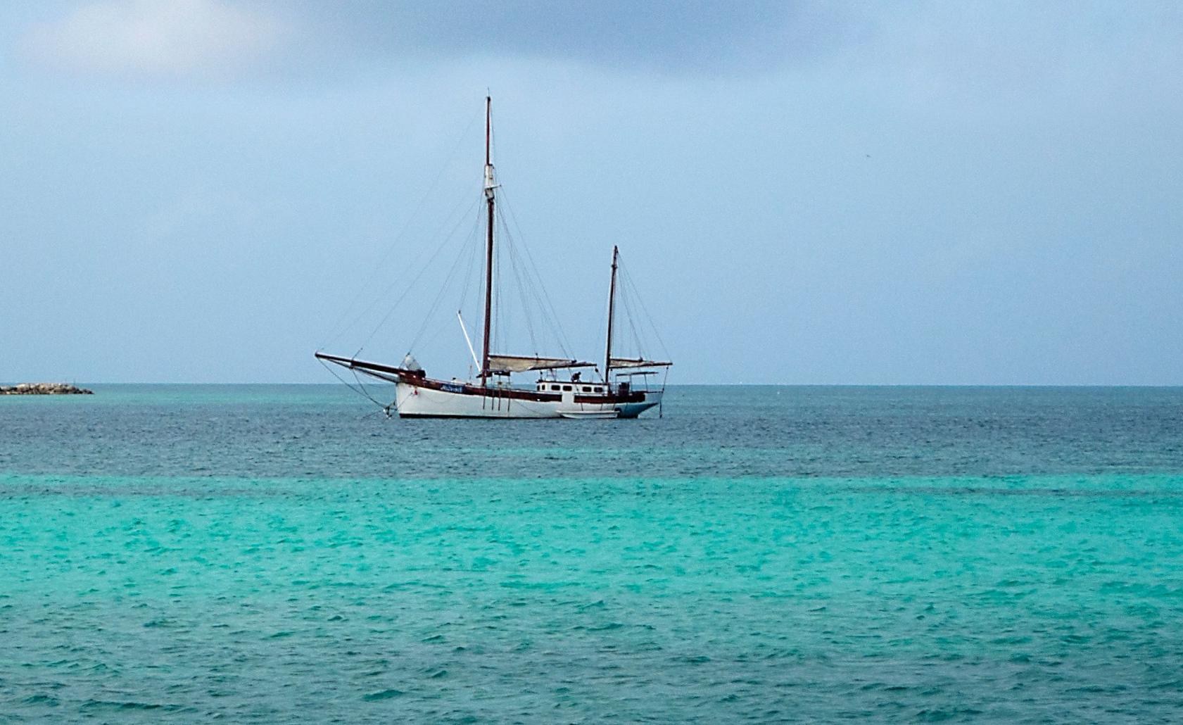 An old ship on an emerald sea.