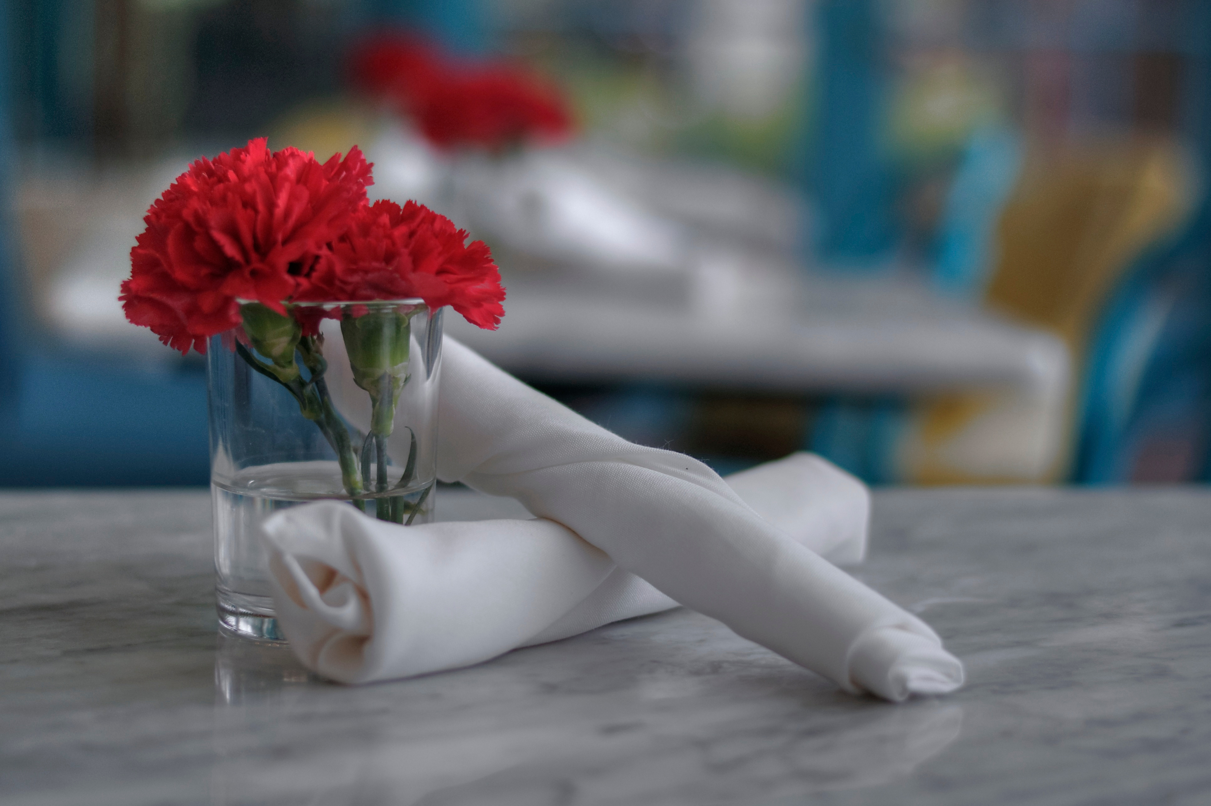 Formal silverware at an empty table.